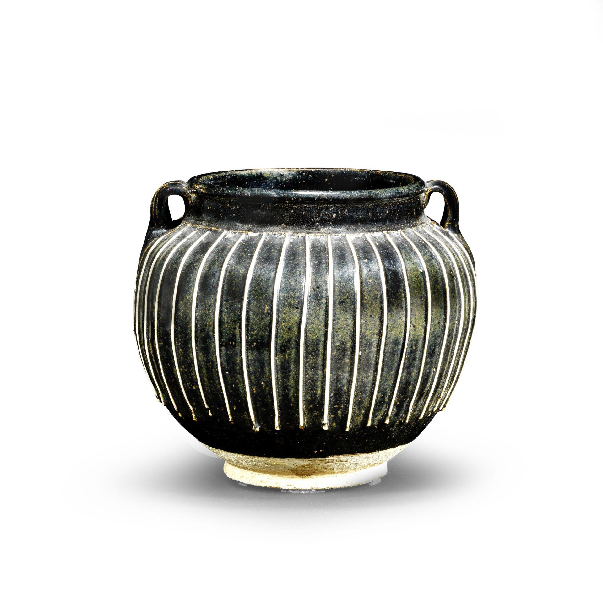 A BLACK-GLAZED 'RIBBED' JAR Northern Song/Jin Dynasty