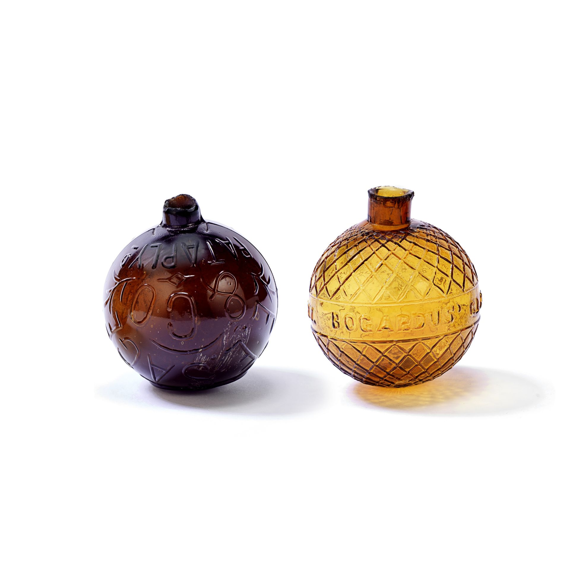 A very rare American glass target ball by E E Sage & Co and an A H Bogardus ball, dated 1877
