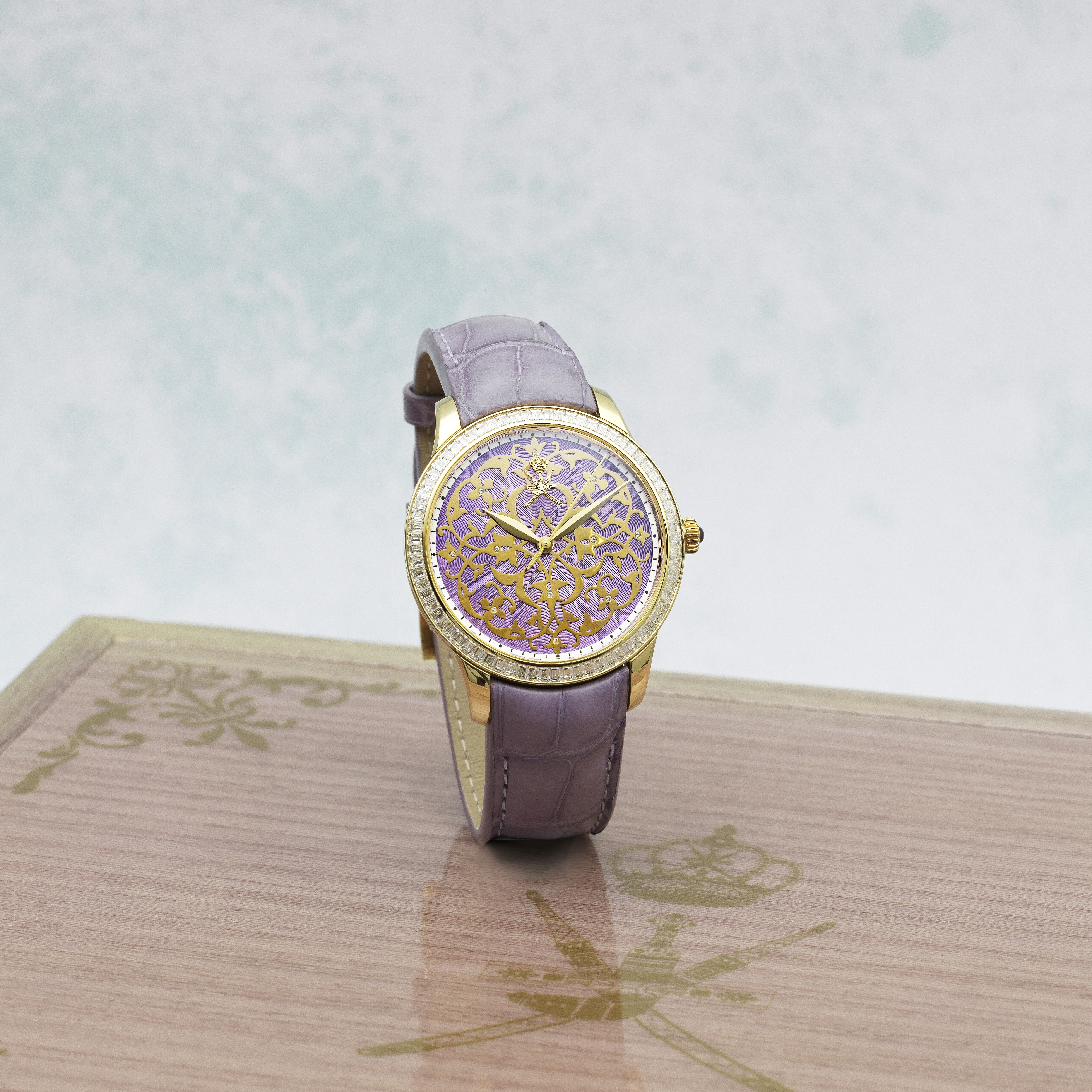 William & Son. An unusual 18K gold and diamond set automatic wristwatch with Khanjar emblem and e...