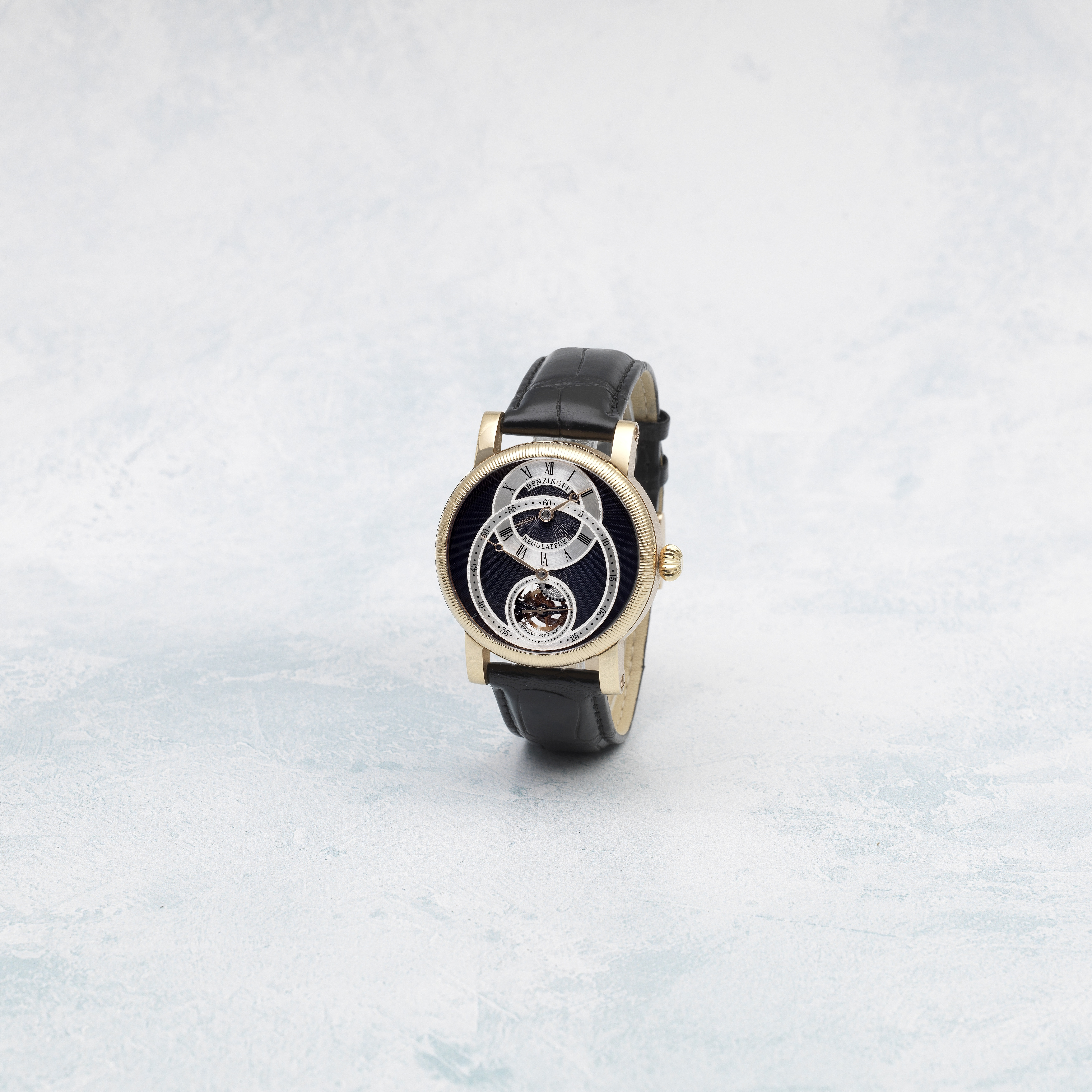 Benzinger. An 18k rose gold manual wind wristwatch with regulator style dial and skeletonised mov...