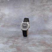 Patek Philippe. A stainless steel automatic calendar wristwatch Aquanaut, Ref: 5060A-001, Circa 1997