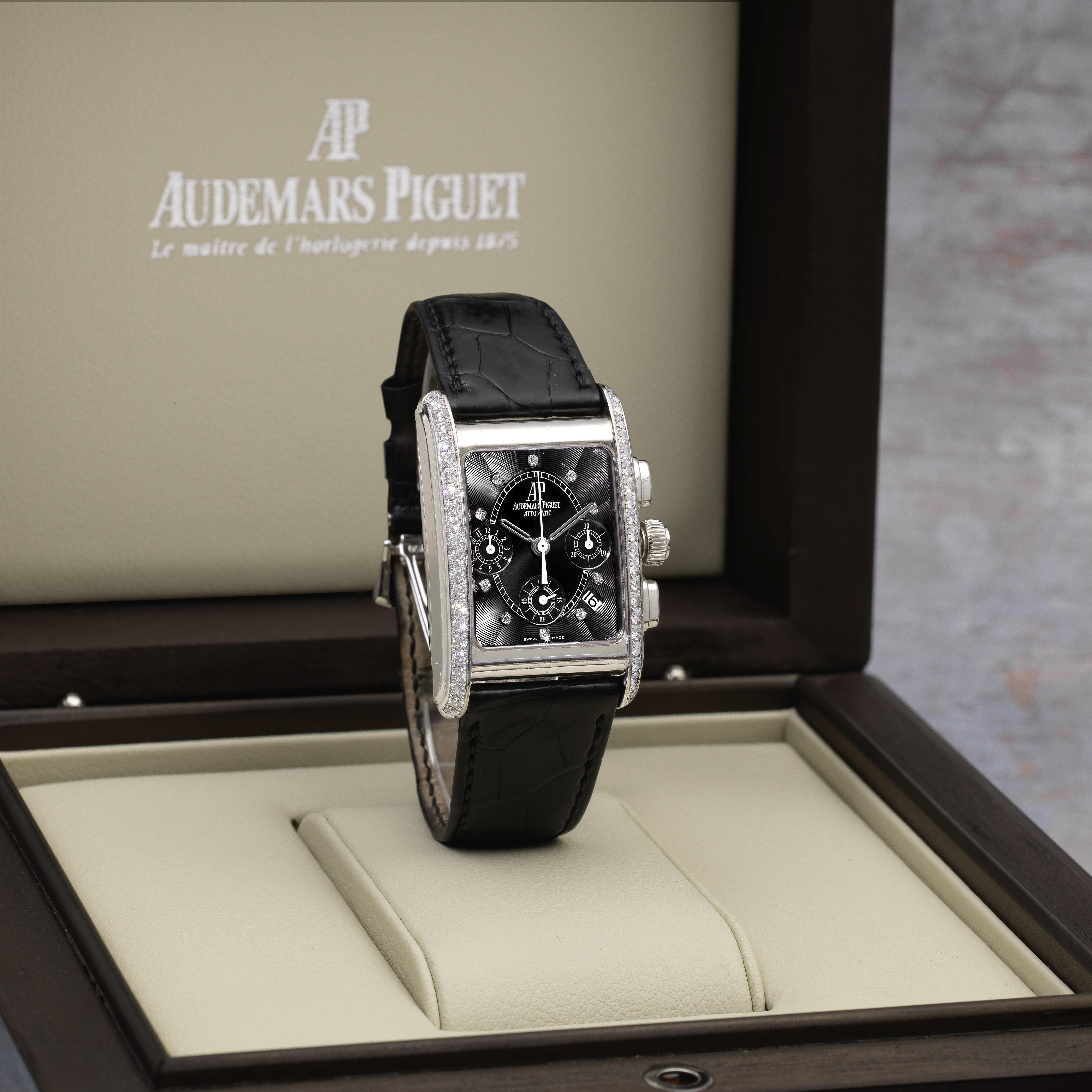 Audemars Piguet. An 18K white gold and diamond set automatic calendar chronograph wristwatch Ed...