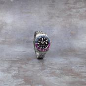 Rolex. A stainless steel automatic calendar bracelet watch with dual time zone GMT Master 'Fuchs...