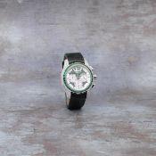 Chopard. A limited edition 18K white gold, emerald and diamond set automatic wristwatch Elton Jo...