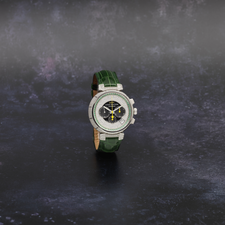Louis Vuitton. An 18K white gold, diamond and emerald set automatic calendar chronograph wristwat...