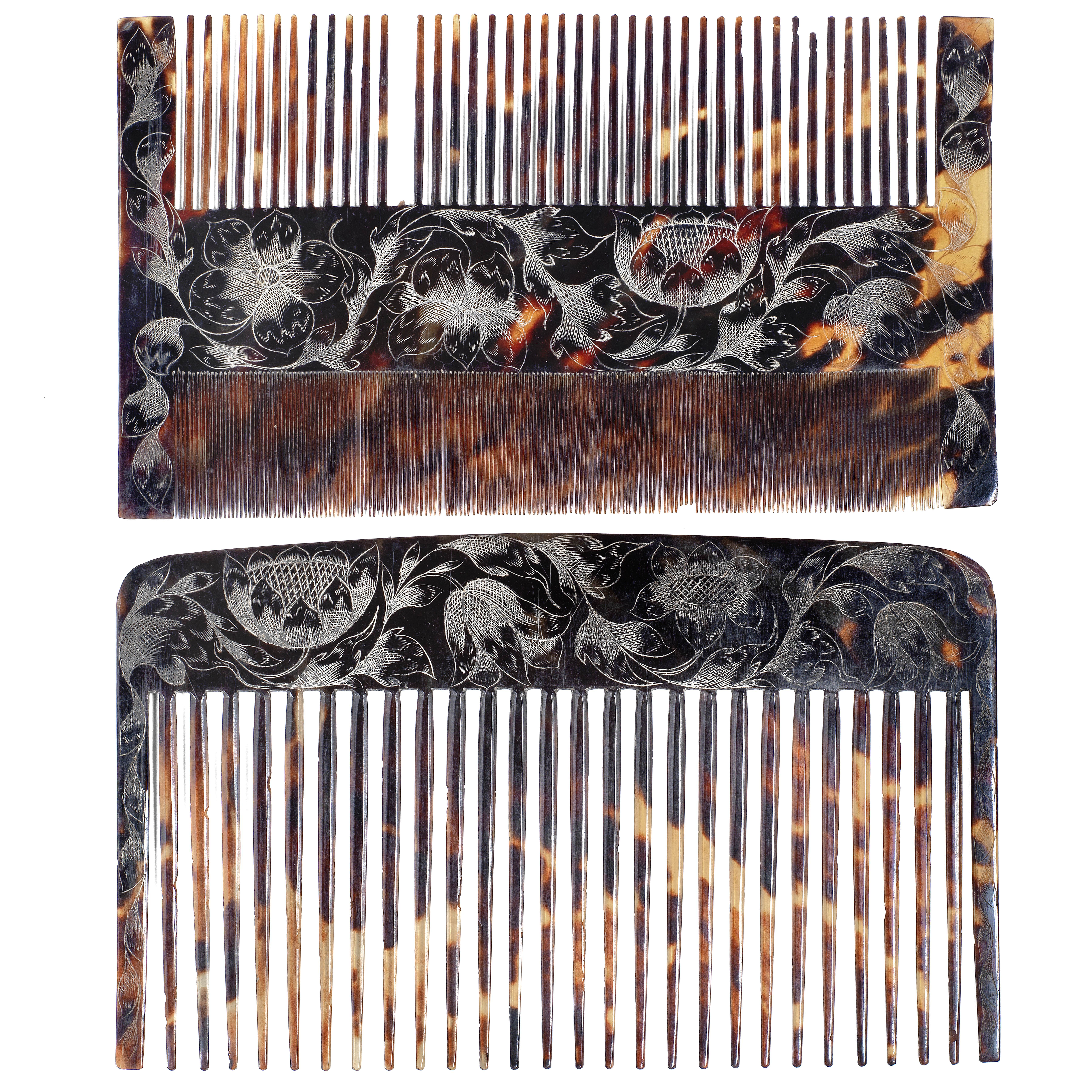 A rare late 17th century Jamaican colonial engraved tortoiseshell wig comb case containing two co...