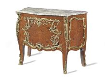 A French late 19th century ormolu mounted kingwood, bois satine and 'bois de bout' (end-cut) marq...
