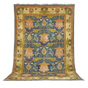 A vibrant Gavin Morton Donegal carpet early 20th century 560cm x 360cm approximately