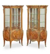 A pair of French late 19th century ormolu mounted kingwood, bois satine and marquetry bombe serpe...