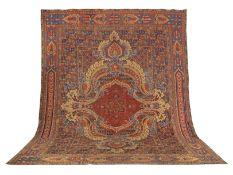 A striking Axminster carpet with central medallion England 641cm x 484cm