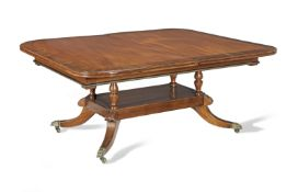 An Irish Regency mahogany and rosewood banded extending dining table possibly by Mack, Williams a...