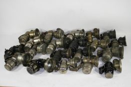 A collection of twenty acetylene generated cycle lamps, ((Qty))