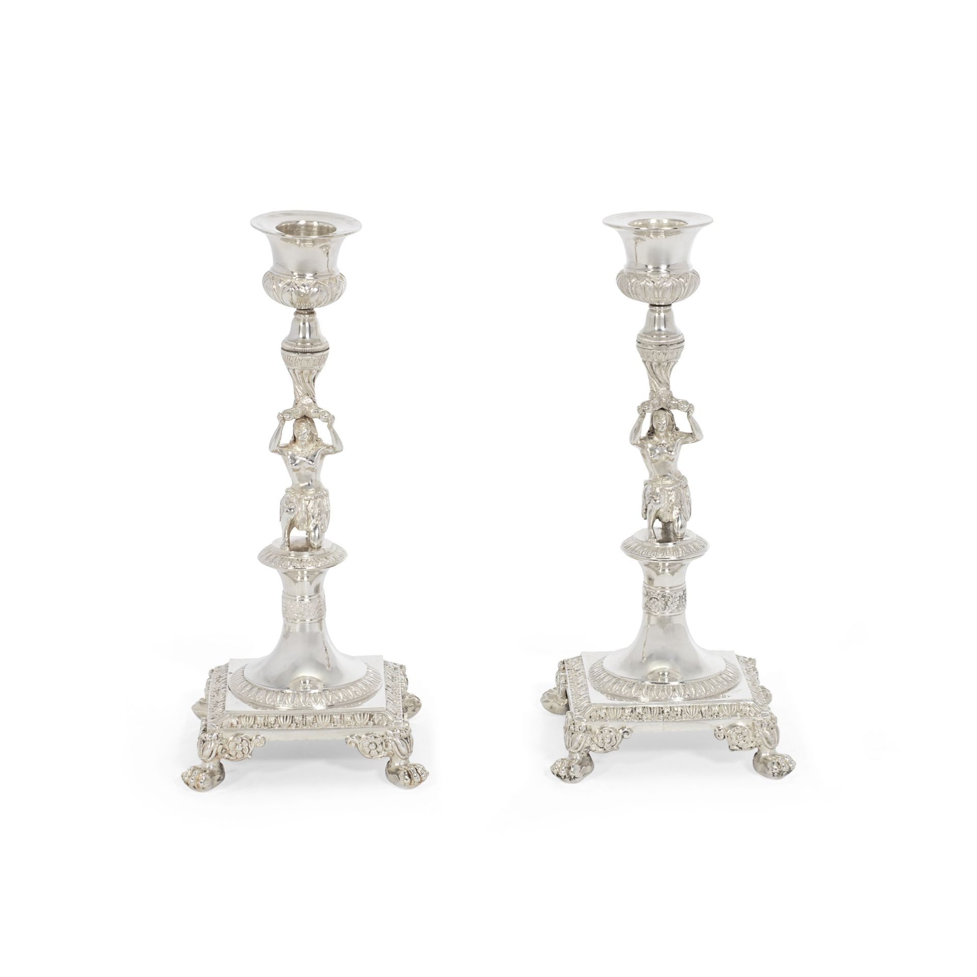 A pair of silver figural candlesticks maker's mark rubbed, with French first standard mark for Pa...