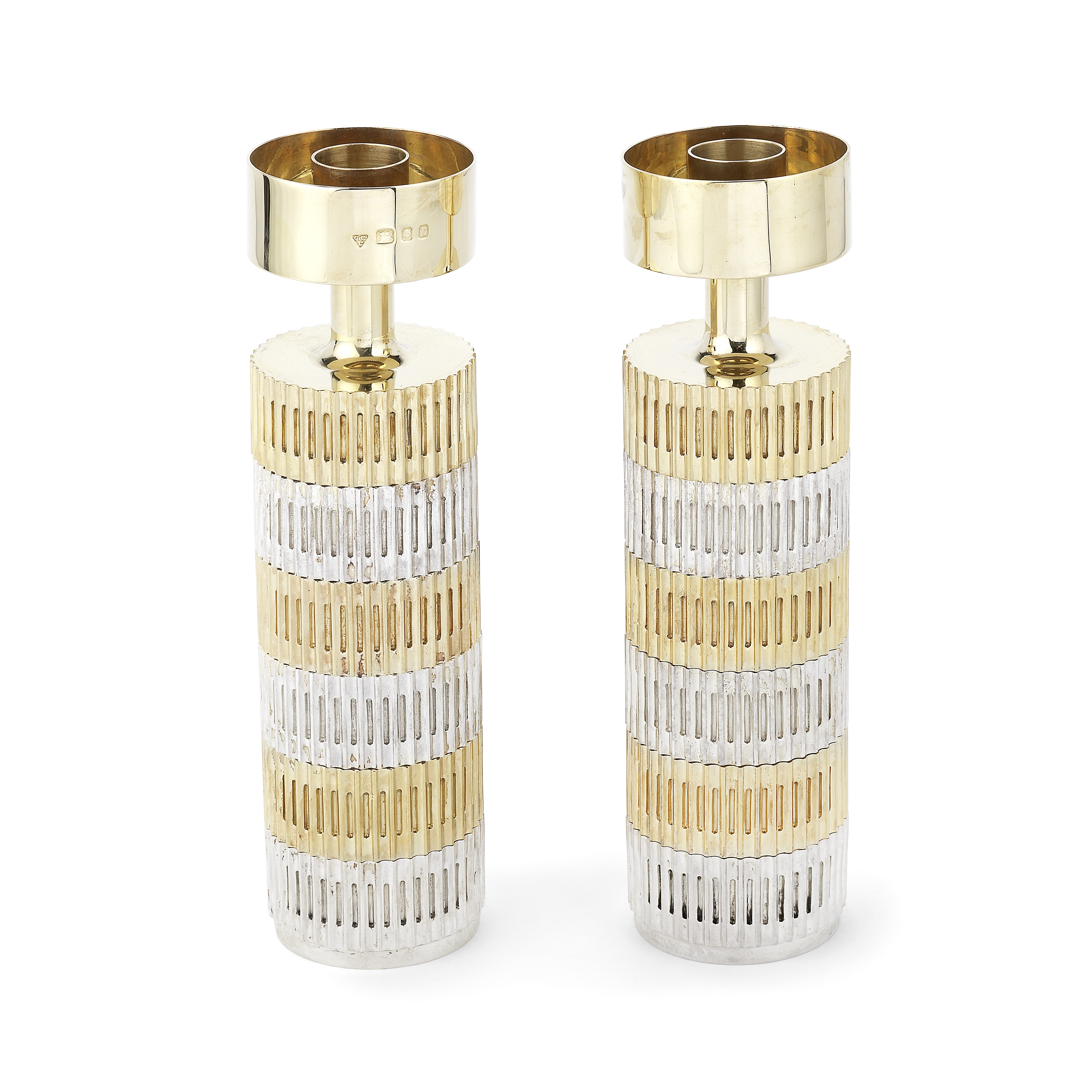 ALEX STYLES FOR GARRARD: an unusual pair of silver and silver-gilt candlesticks mark for Garrard ...