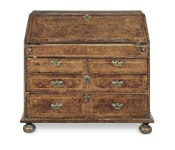 A Queen Anne walnut and featherbanded bureau