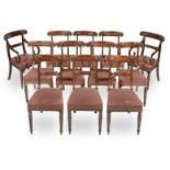 A set of eighteen mahogany and ebonised dining chairs in the Regency style (18)