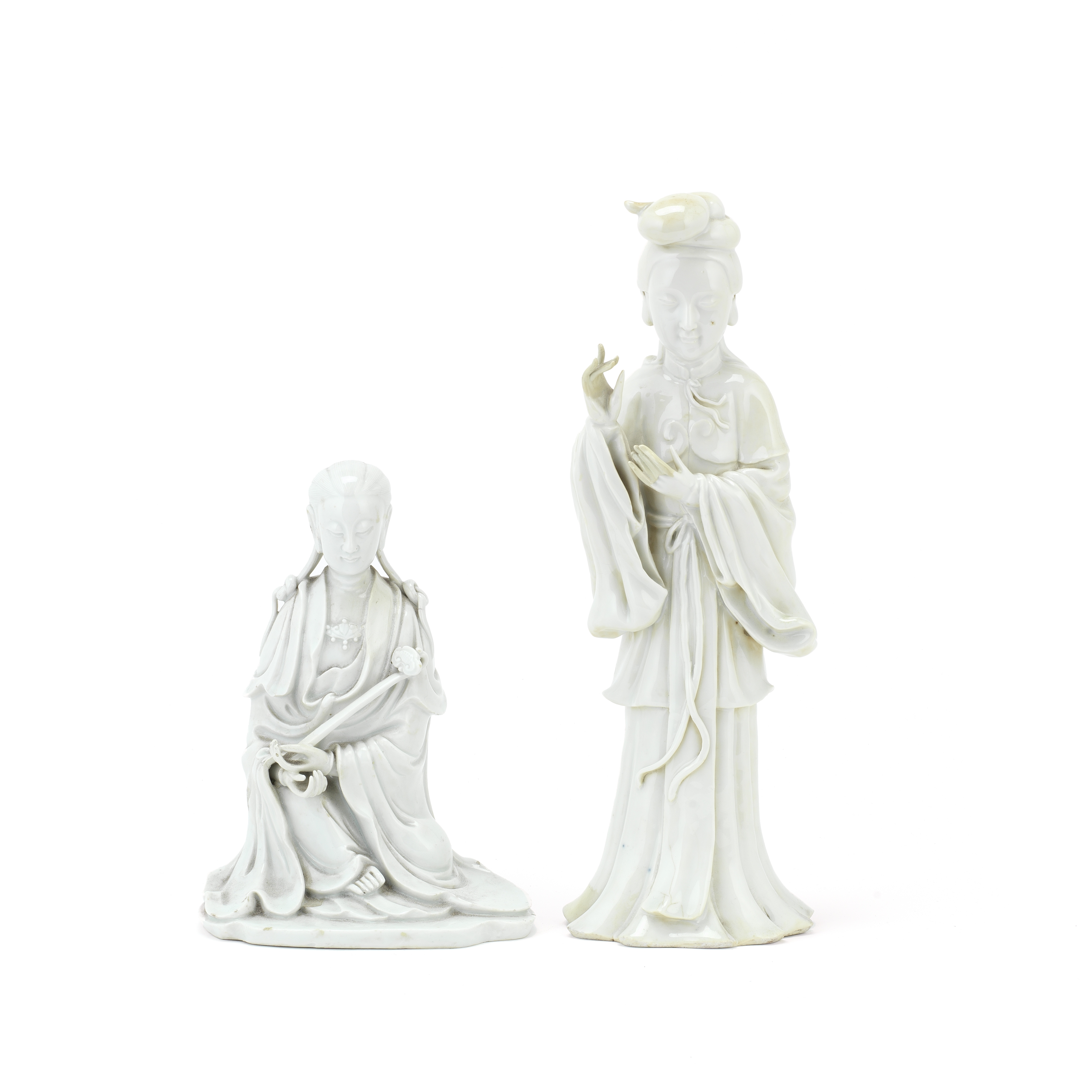 Two blanc-de-chine figures of Guanyin one wth 'xu xin de men' shop mark (1750-1800), the other 19...