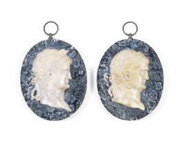 A pair of 19th century Italian 'Grand Tour' Giallo Antico marble portrait reliefs of Roman empero...