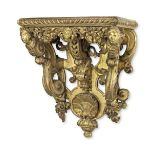 A large 19th century carved wood, gilt gesso and composition wall bracket in the rench Régen...