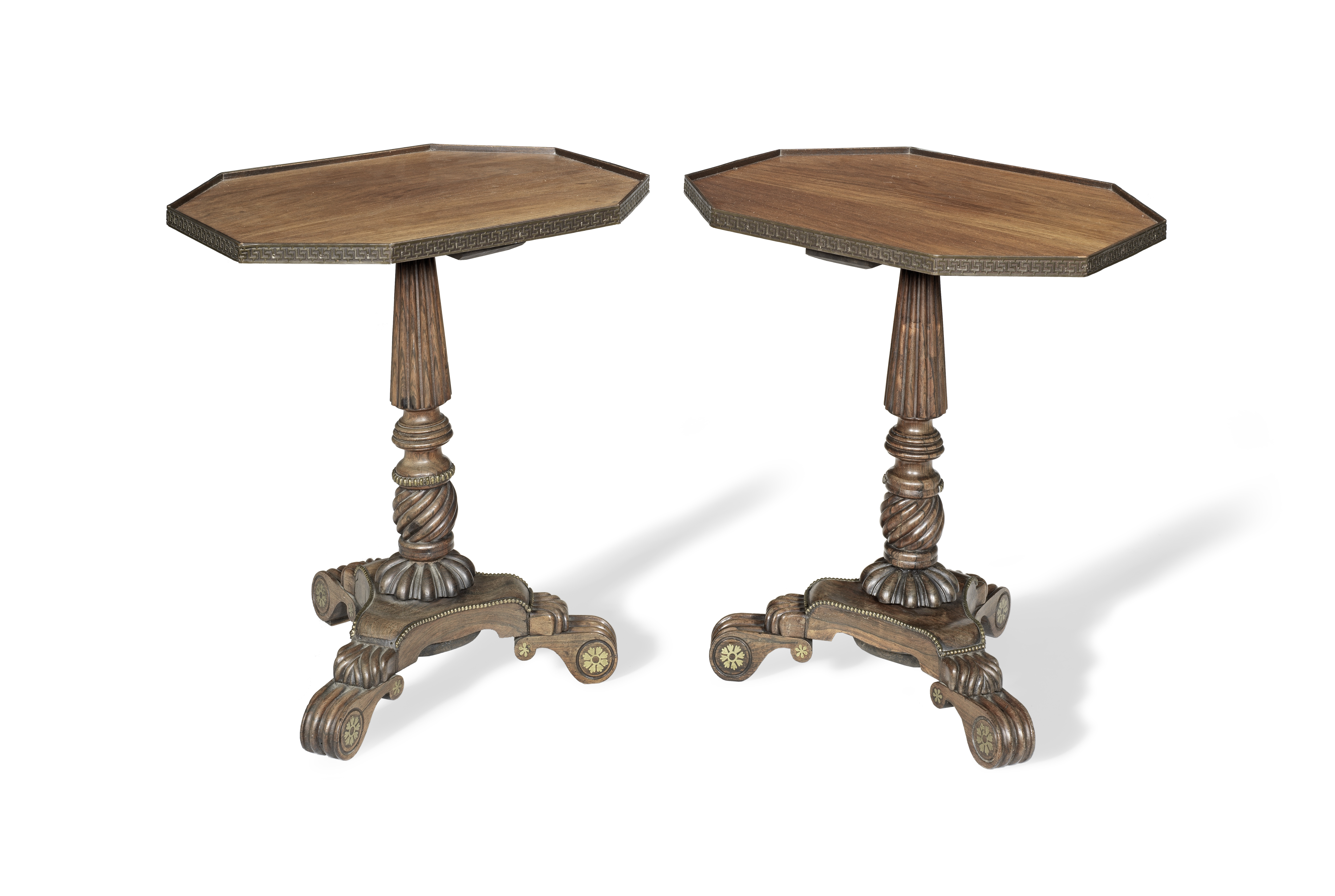 A pair of rosewood and brass mounted occasional tables adapted from a pair of Regency pole screen...
