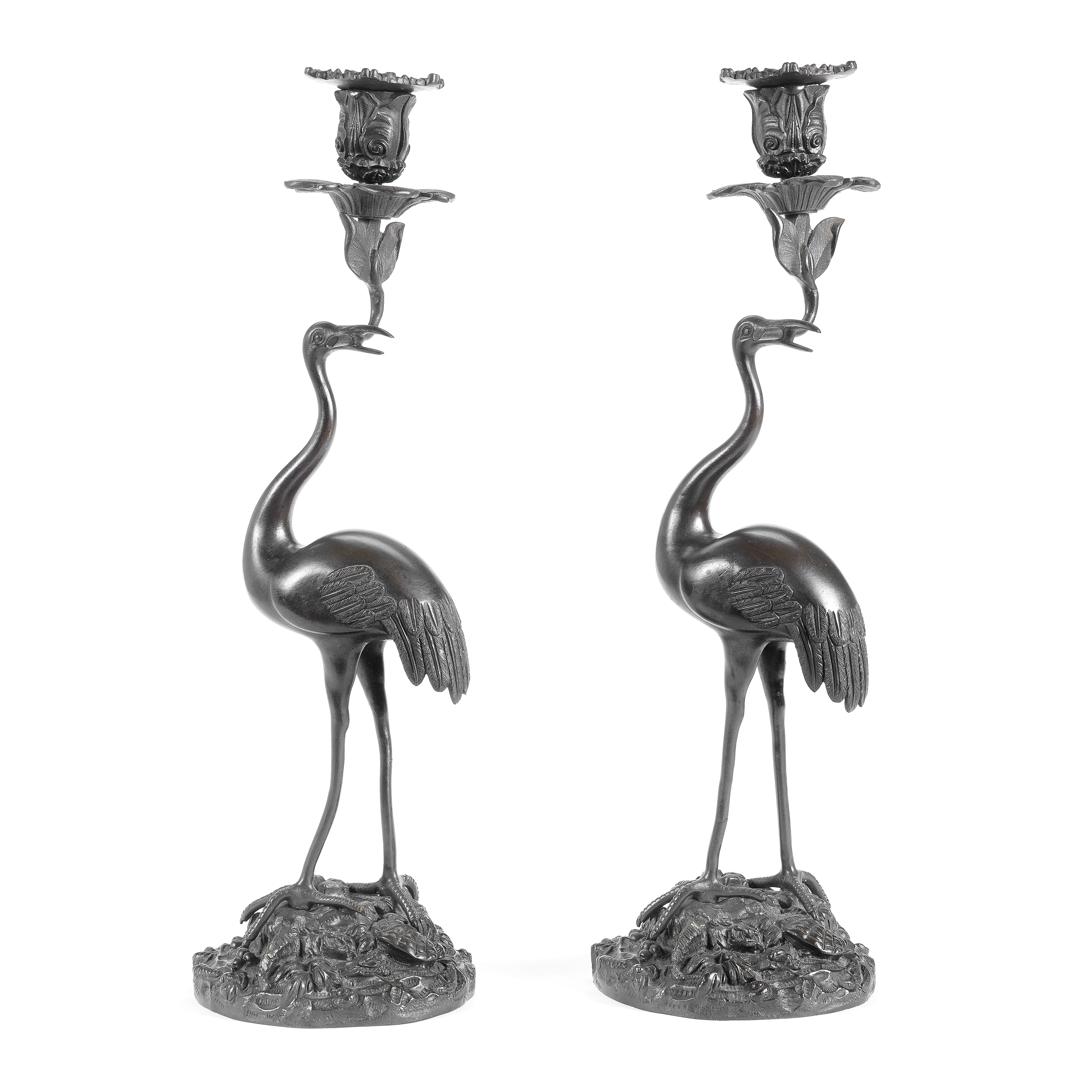 A pair of mid 19th century patinated bronze crane candlesticks in the manner of Thomas Abbott (2)