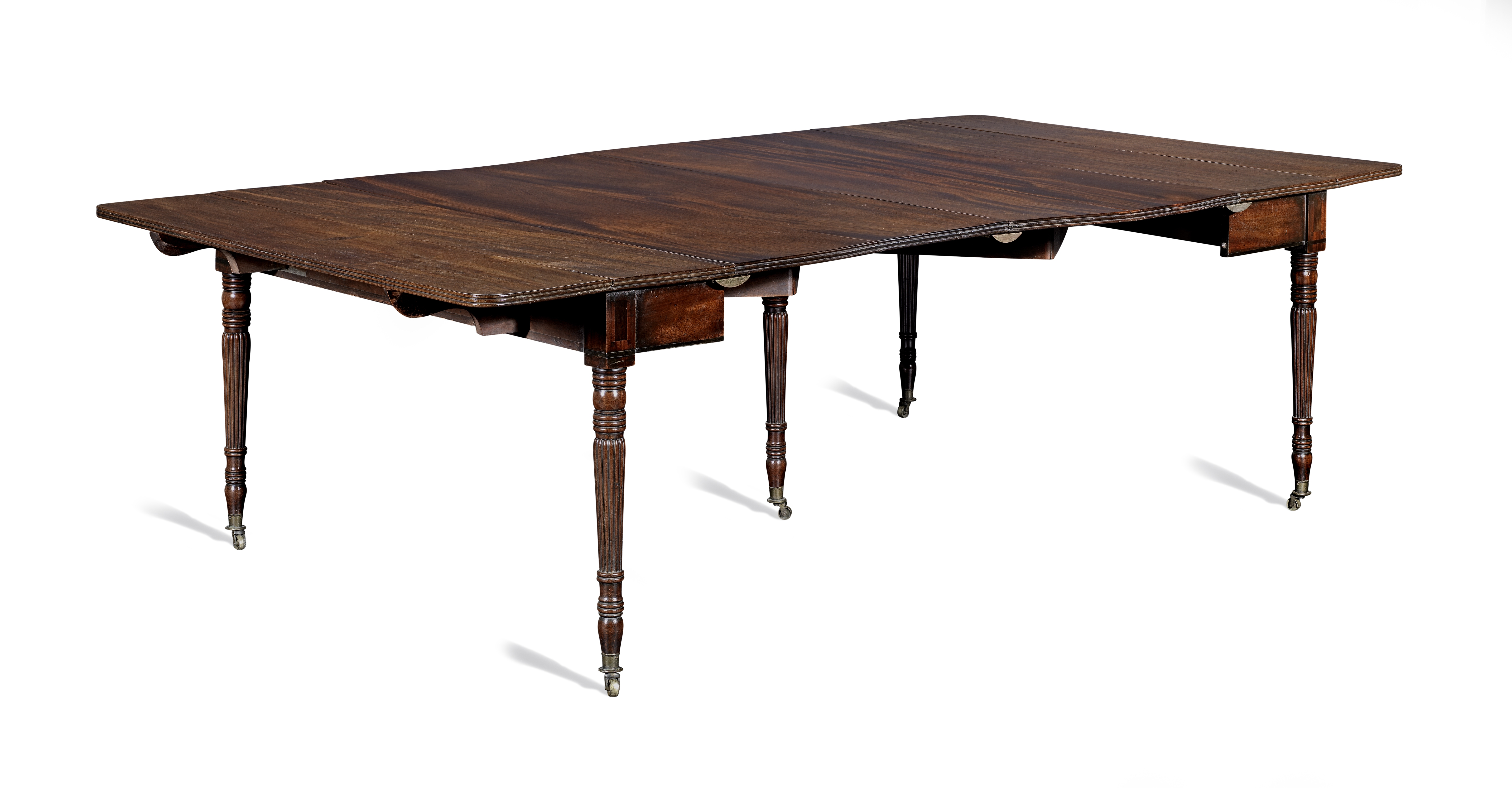 A Regency mahogany and ebonised inlaid concertina-action extending dining table