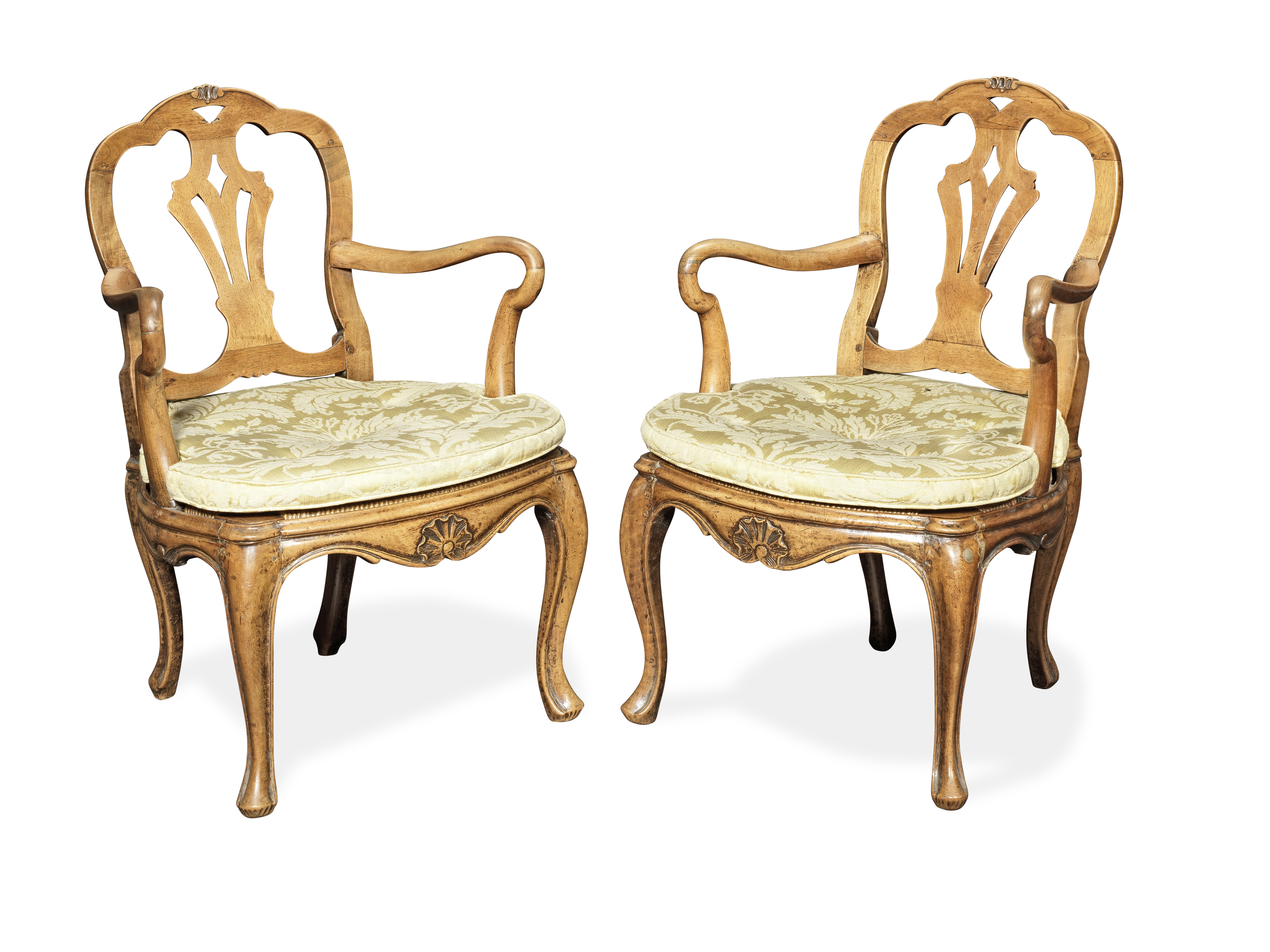 A pair of 18th Century Italian Provincial carved walnut open armchairs (2)