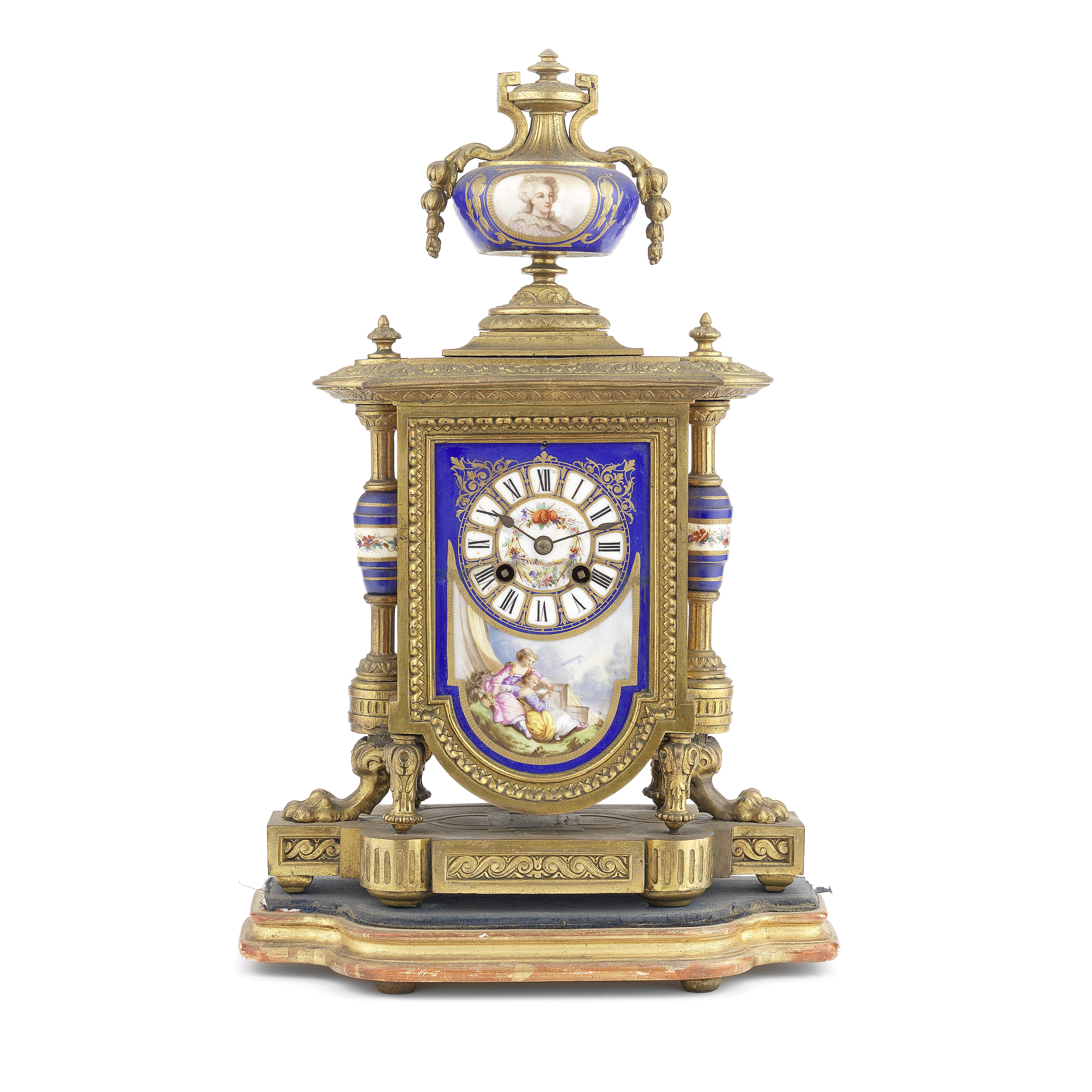 A late 19th century French gilt spelter and Sevres style porcelain mounted mantel clock the movem...