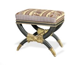 A German or North European early 19th century painted and parcel gilt x-frame stool