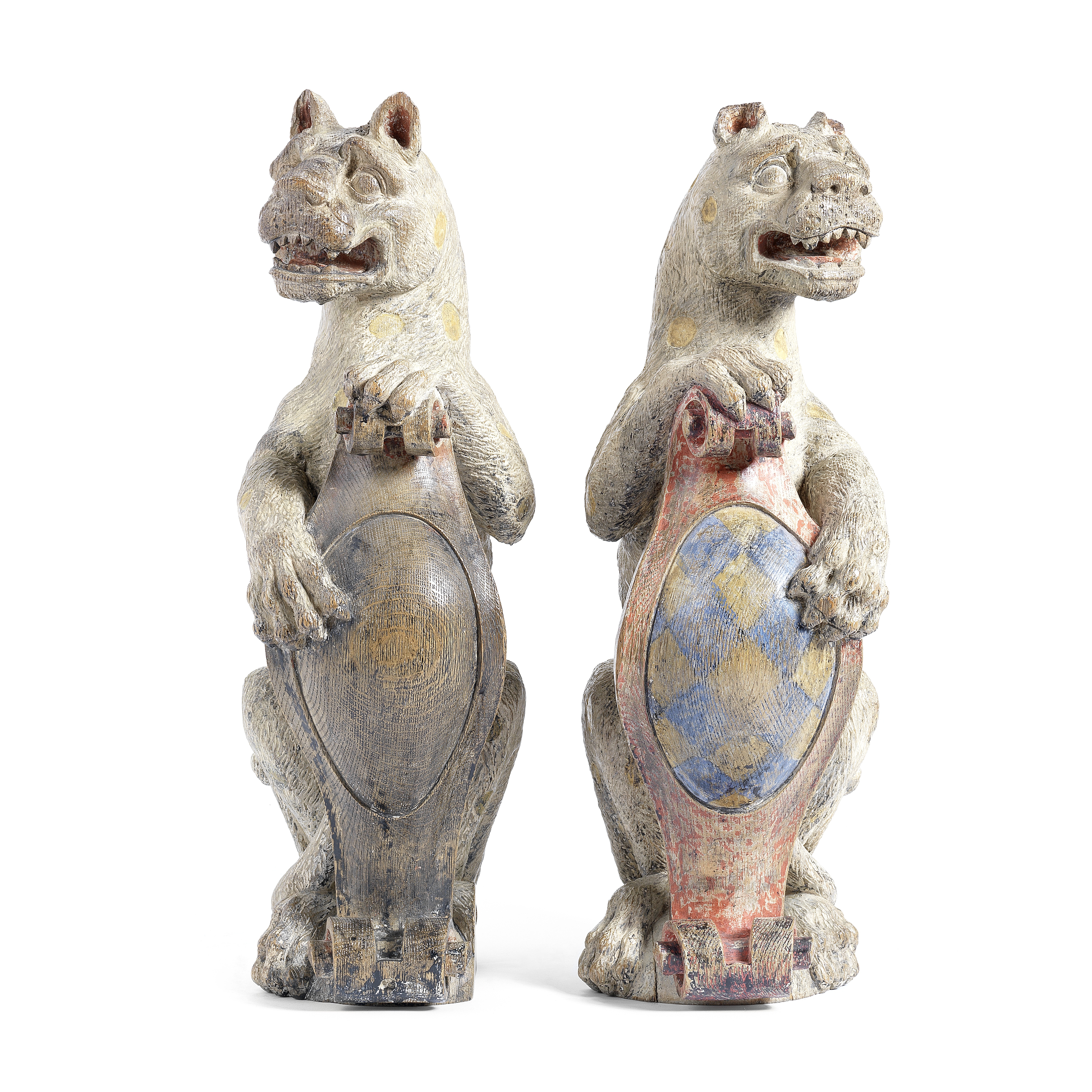 A pair of carved and polychrome decorated oak heraldic finials in the James I style (2)