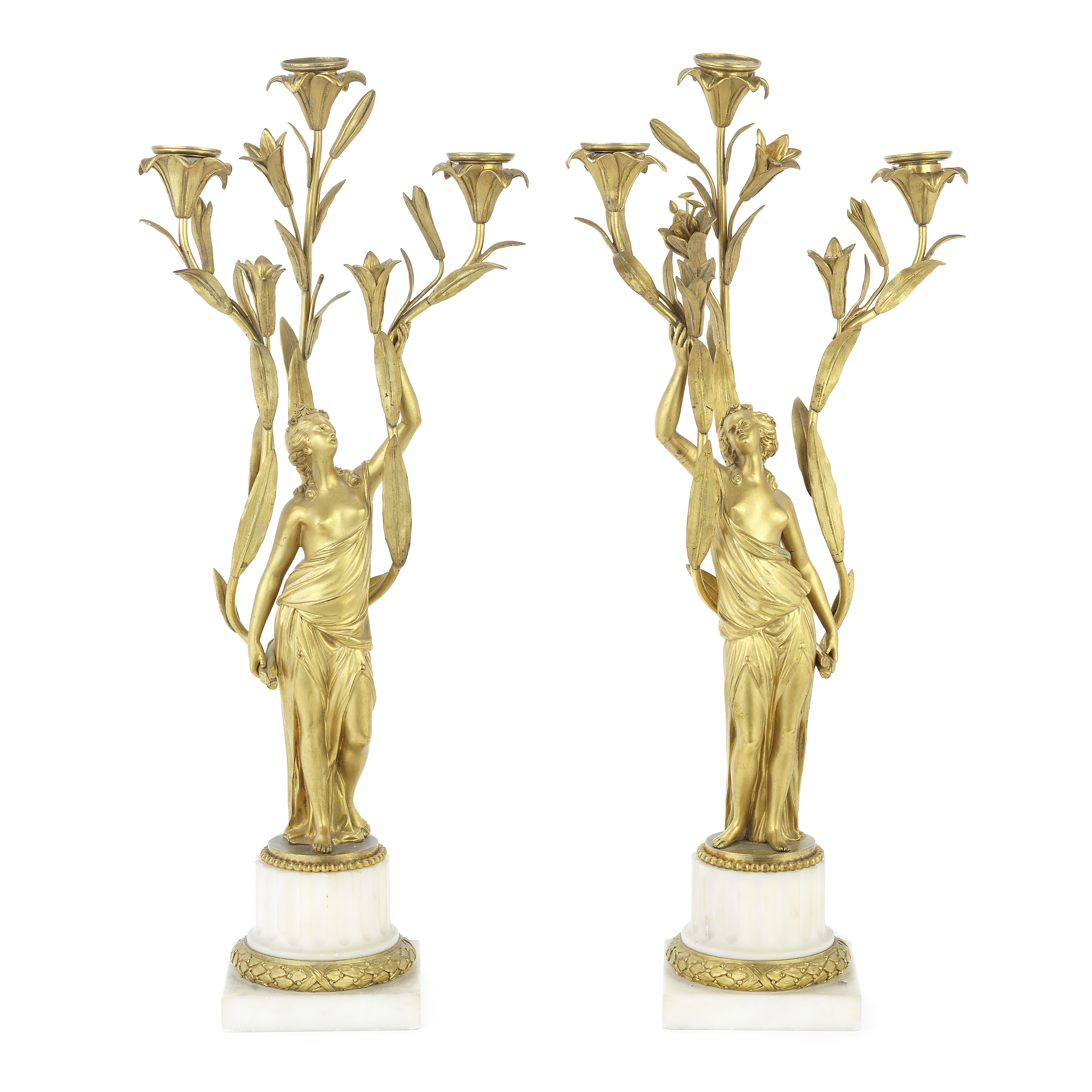 A pair of 19th century French gilt bronze and white marble figural three light candelabra in the ...