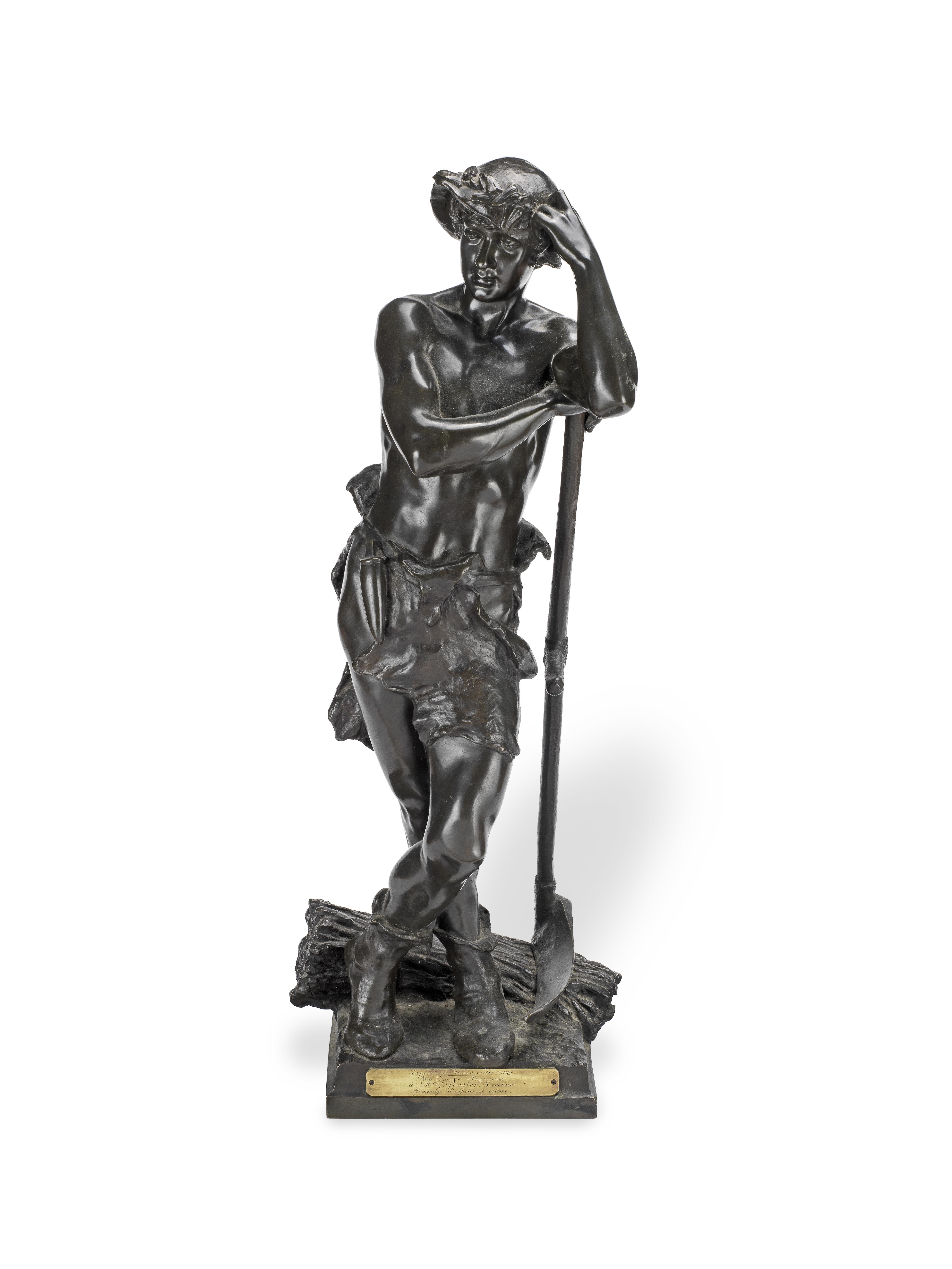 Eugène Marioton (French, 1854 - 1925): A patinated bronze figure of a farm hand