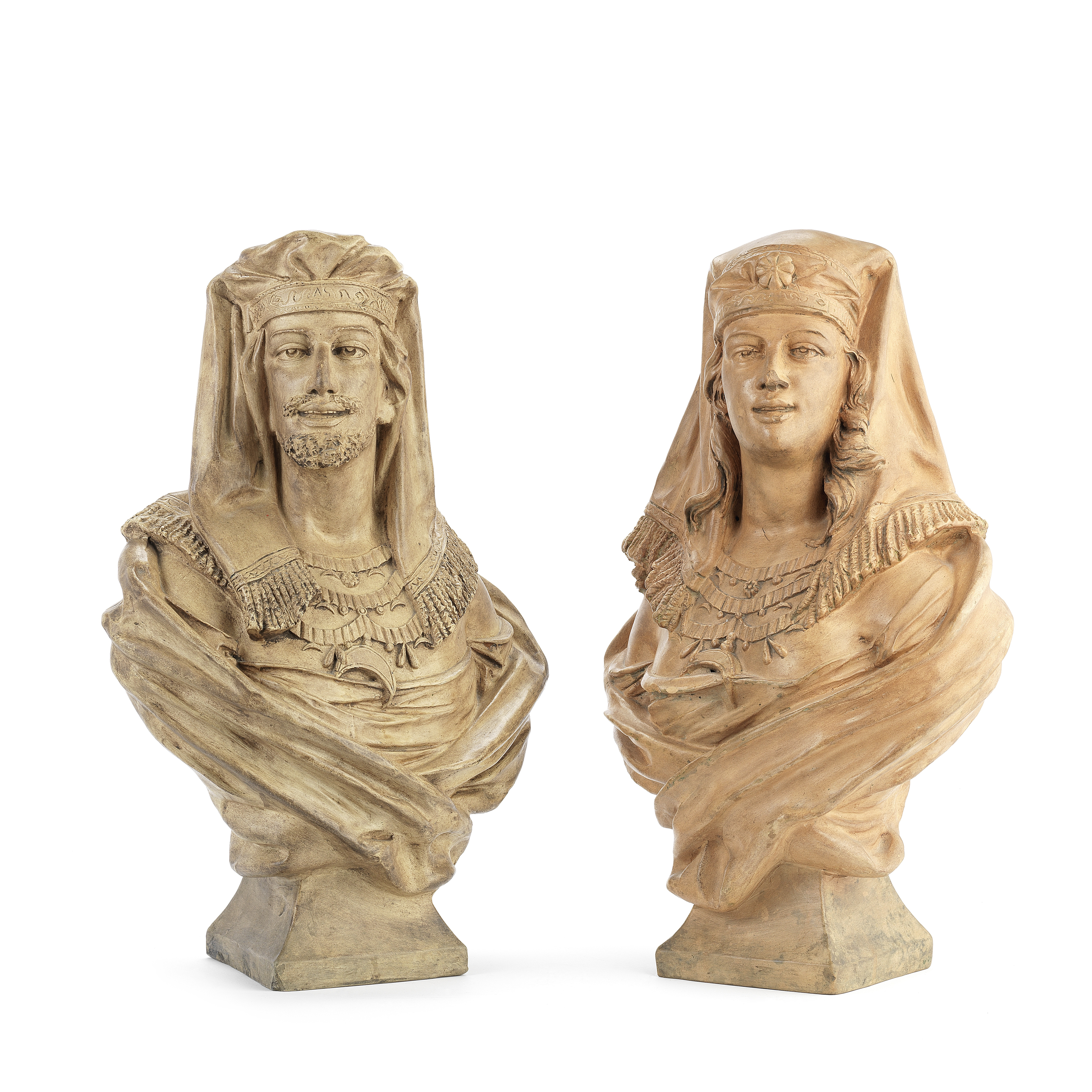 A pair of late 19th century French terracotta busts of a male and female Moor by William Guerin &...
