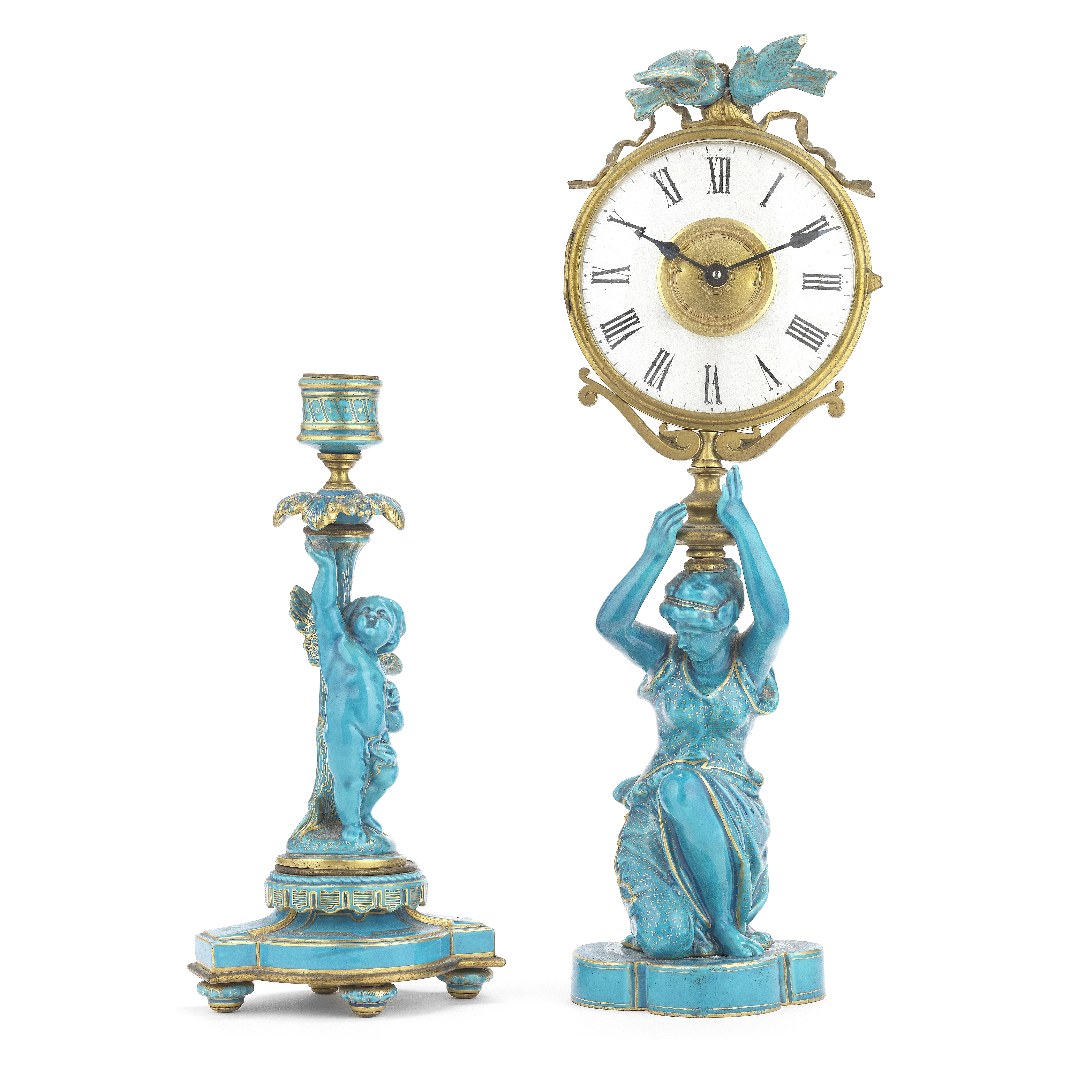 A gilt brass, frosted glass and turquoise glazed ceramic figural mystery time piece together with...