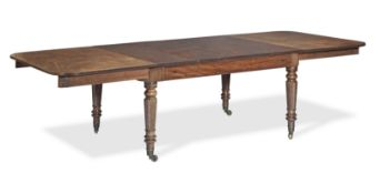 A Regency mahogany and ebonised inlaid extending dining table