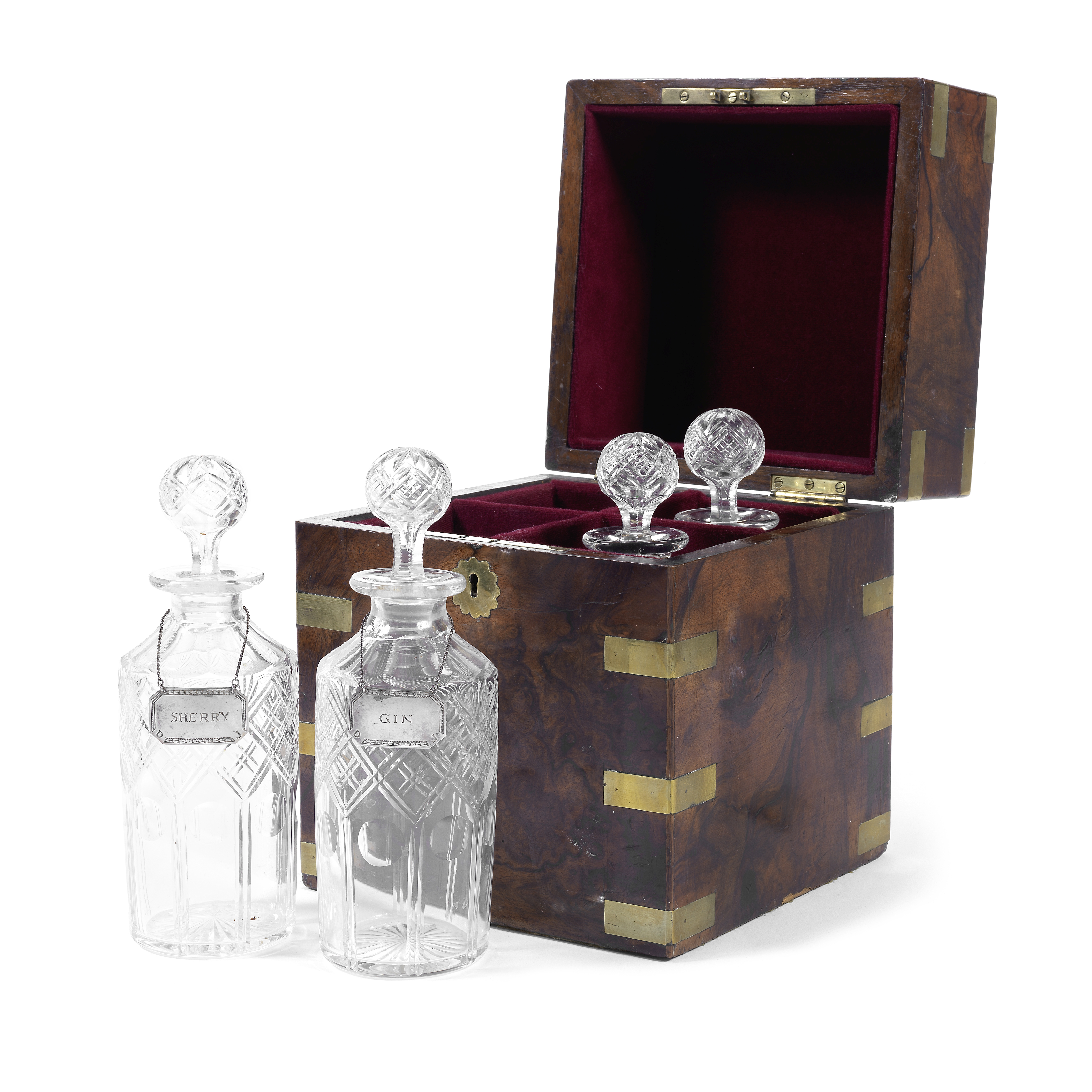 A late Victorian burr walnut and brass mounted decanter box