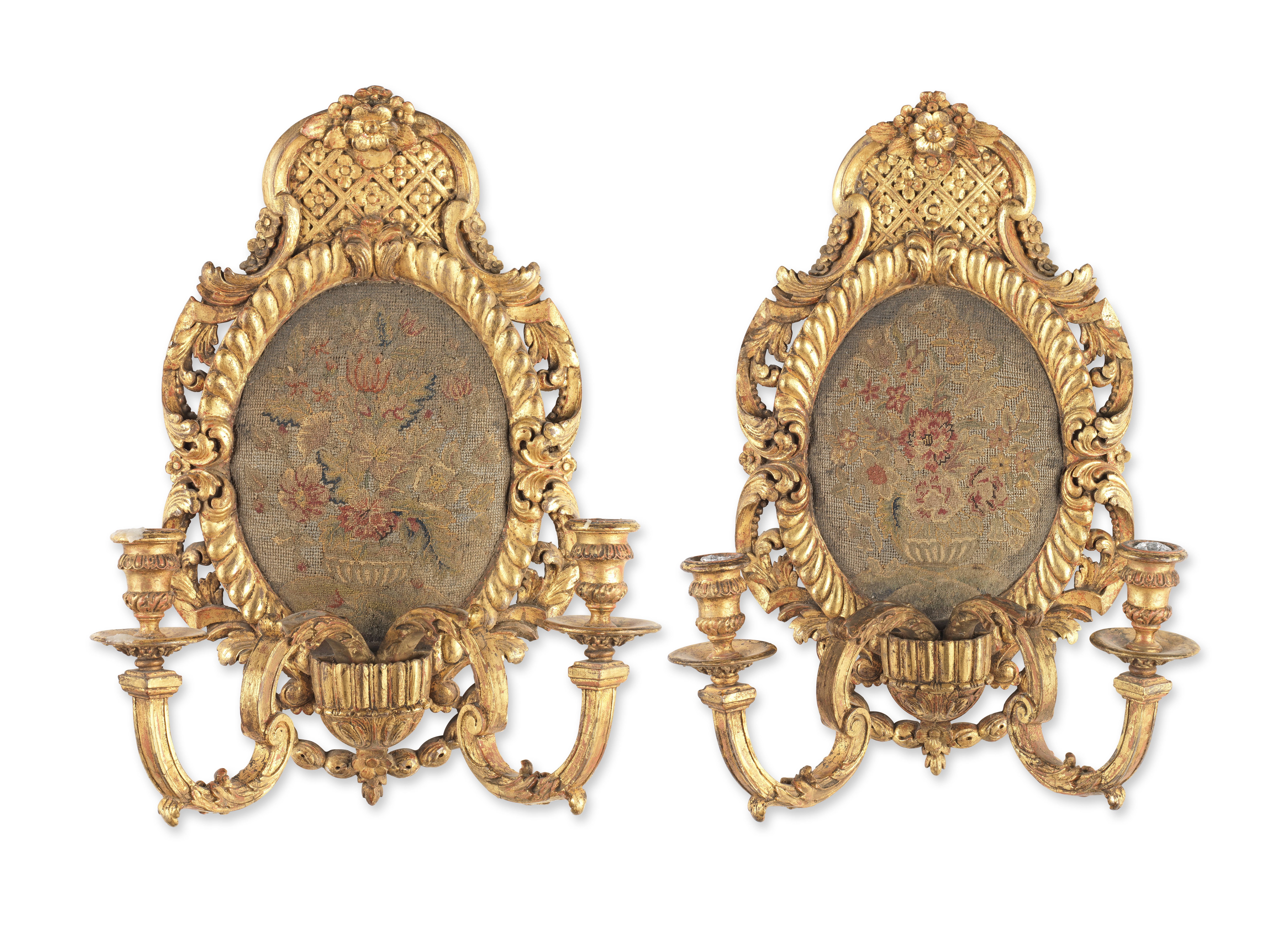 A pair of 19th century carved wood and gilt gesso composition twin light wall appliques in the L...