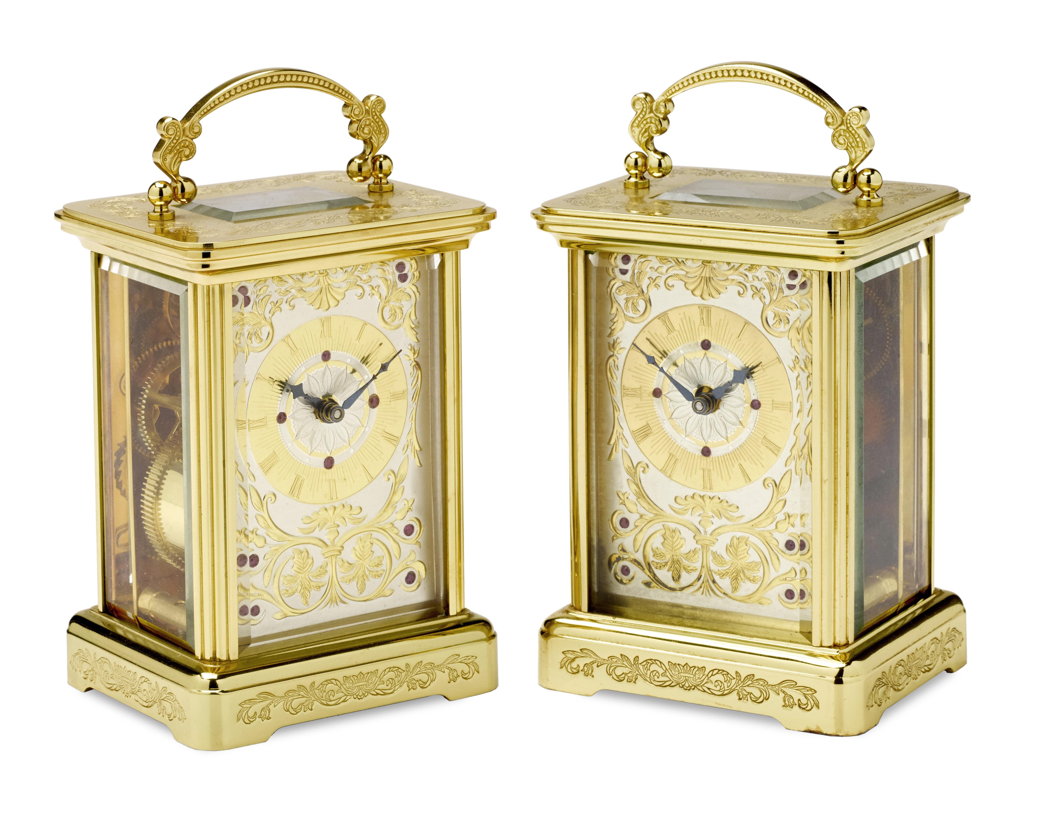 A pair of modern engraved gilt brass carriage timepieces the dials signed Igor Carl Fabergé 2