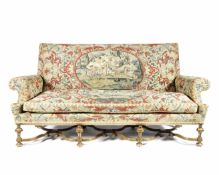 A Carolean style walnut and needlework upholstered sofa The upholstery, 18th century, the frame, ...