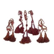 Two pairs of claret tie-backs 19th century