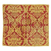 A woven cover of crimson silk and yellow linen Early 17th century, Italian