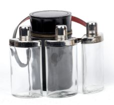 A leather-cased travelling set of three sprits flasks,