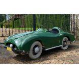 A 'Jaguar' type child's car,