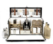 A cased 'Coracle' picnic set for four persons by G.W.Scott & Sons, circa 1909,