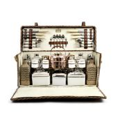 A 'Coracle' wicker-cased picnic set for four persons by G.W.Scott & Sons, 1930s,