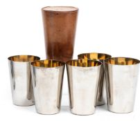 A vintage leather-cased set of five graduated beakers,