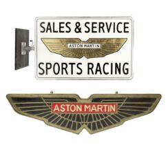 An 'Aston Martin - Sales & Service Sports Racing' illuminating display sign, ((2))