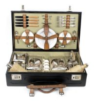 A vintage cased picnic set for four persons by Drew & Co, Leadenhall St,