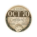 A UK tax disc issued to the James Bond 'Goldfinger' Aston Martin DB5 and signed letter of authent...