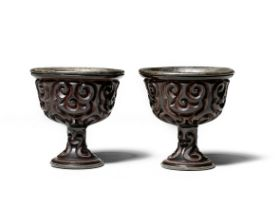 A PAIR OF CARVED TIXI LACQUER STEM CUPS 16th century (2)